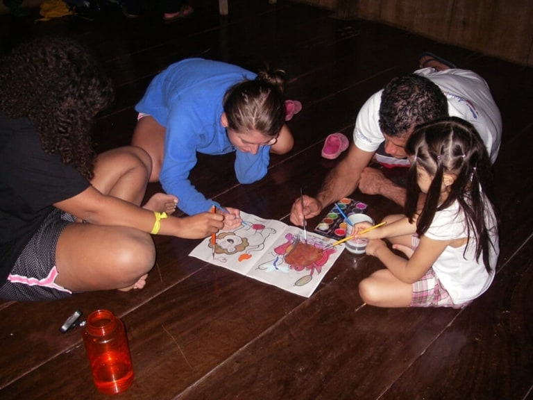 Students painting with local children - Pure Life Adventure in Costa Rica