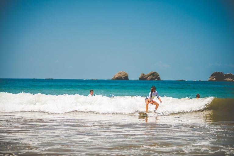 Young adults surfing - Pure Life Adventure in Costa Rica
