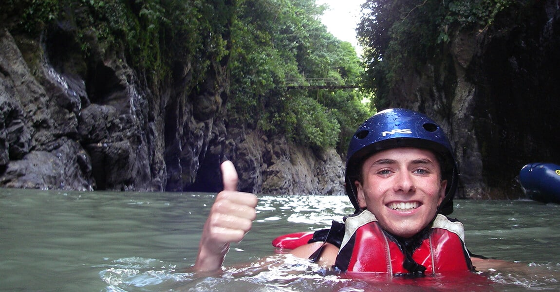Student in a River in Costa Rica during Pure Life Adventure Therapy. Wilderness Therapy for young adults.