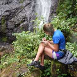 Young adult at waterfall. Wilderness and Adventure Therapy for Young Adults. Pure Life in Costa Rica.