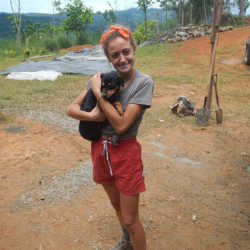 Student holding dog. Wilderness and Adventure Therapy for Young Adults. Pure Life in Costa Rica.