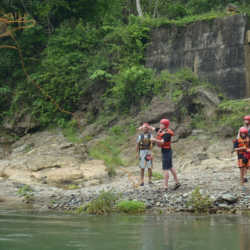Young adults at river. Wilderness and Adventure Therapy for Young Adults. Pure Life in Costa Rica.