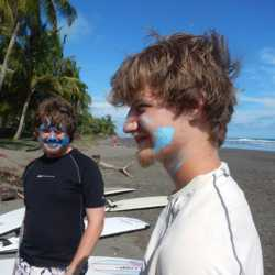 Young adults surfing. Wilderness and Adventure Therapy for Young Adults. Pure Life in Costa Rica.
