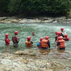 Young adults swimming. Wilderness and Adventure Therapy for Young Adults. Pure Life in Costa Rica.