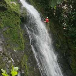 Student descending waterfall. Wilderness and Adventure Therapy for Young Adults. Pure Life in Costa Rica.
