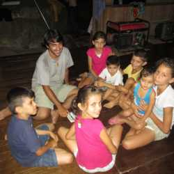 Student teaching children. Wilderness and Adventure Therapy for Young Adults. Pure Life in Costa Rica.