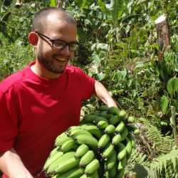 Young adult with bananas. Wilderness and Adventure Therapy for Young Adults. Pure Life in Costa Rica.