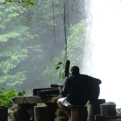Student playing music. Wilderness and Adventure Therapy for Young Adults. Pure Life in Costa Rica.