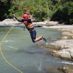 Student jumping in river. Wilderness and Adventure Therapy for Young Adults. Pure Life in Costa Rica.