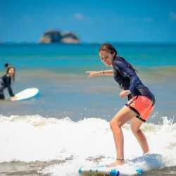 Student surfing. Wilderness and Adventure Therapy for Young Adults. Pure Life in Costa Rica.