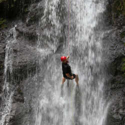 Students climbing waterfall. Wilderness and Adventure Therapy for Young Adults. Pure Life in Costa Rica.