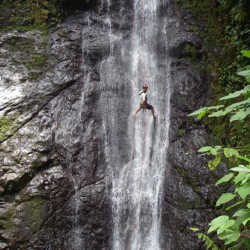 Student descends waterfall. Wilderness and Adventure Therapy for Young Adults. Pure Life in Costa Rica.
