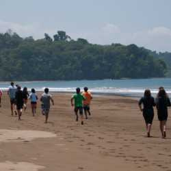 Young adults running. Wilderness and Adventure Therapy for Young Adults. Pure Life in Costa Rica.