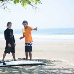 Surf lessons. Wilderness and Adventure Therapy for Young Adults. Pure Life in Costa Rica.